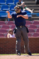 Home plate umpire Drew Ashcraft calls a strike during a Carolina League game between the Potomac Nationals and the Winston-Salem Dash at Wake Forest Baseball Park May 10, 2009 in Winston-Salem, North Carolina. (Photo by Brian Westerholt / Four Seam Images)