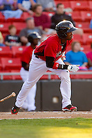 Jurickson Profar #10 of the Hickory Crawdads starts down the first base line against the Augusta GreenJackets at L.P. Frans Stadium on April 29, 2011 in Hickory, North Carolina.   Photo by Brian Westerholt / Four Seam Images