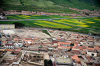 The Tibetan neighborhood of Xiahe, Gansu, China, stretches out into grassland in the neighboring countryside.  Xiahe, home of the Labrang Monastery, is an important site for Tibetan Buddhists.  The population of the town is divided between ethnic Tibetans, Muslims, and Han Chinese.