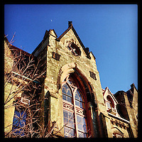 A tiny sliver of moon rises above College Hall at the University of Pennsylvania on a sunny afternoon February 15, 2013.