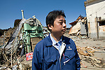 Michihiro Kohno, president of soy sauce and miso soup maker Yagisawa Shoten, looks at the wreckage that was his family's 207-year-old company in Rikuzentakata, Iwate Prefecture, Japan on 06 April, 2011. .Photographer: Robert Gilhooly