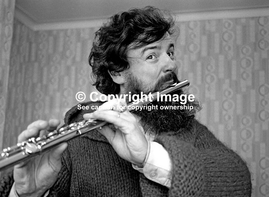 N Ireland-born virtuoso flautist James Galway enjoys a session with two old friends from flute band days in Belfast during a visit to his home city on 30th January 1976. 197601300073e..Copyright Image from Victor Patterson, 54 Dorchester Park, Belfast, United Kingdom, UK...For my Terms and Conditions of Use go to http://www.victorpatterson.com/Victor_Patterson/Terms_%26_Conditions.html