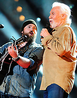 """20 March 2020 - Kenny Rogers, whose legendary music career spanned nearly six decades, has died at the age of 81. Rogers was inducted to the Country Music Hall of Fame in 2013."""" He had 24 No. 1 hits and through his career more than 50 million albums sold in the US alone. He was a six-time Country Music Awards winner and three-time Grammy Award winner. Some of his hits included """"Lady,"""" """"Lucille,"""" """"We've Got Tonight,"""" """"Islands In The Stream,"""" and """"Through the Years."""" His 1978 song """"The Gambler"""" inspired multiple TV movies, with Rogers as the main character. File Photo: 06 June 2013 - Nashville, Tennessee - Zac Brown, Kenny Rogers. 2013 CMA Music Festival Nightly Concert held at LP Field. Photo Credit: Mike Strasinger/AdMedia"""