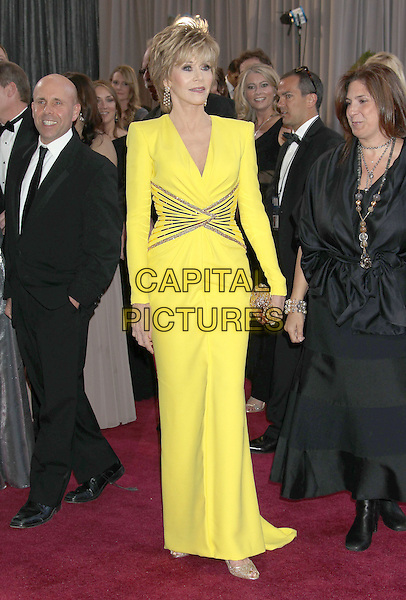 Jane Fonda (wearing Versace).85th Annual Academy Awards held at the Dolby Theatre at Hollywood & Highland Center, Hollywood, California, USA..February 24th, 2013.oscars full length yellow dress gold sequins sequined waist line clutch bag.CAP/ADM/RE.©Russ Elliot/AdMedia/Capital Pictures.