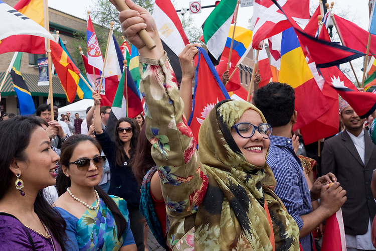 A student waves a flag at the International Street Festival on Court Street on Saturday April 15, 2017. Photo by Kaitlin Owens