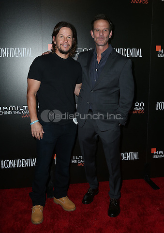 LOS ANGELES, CA - NOVEMBER 06: Mark Wahlberg, Peter Berg  arrive at the 9th Hamilton Behind The Camera Awards at Exchange LA on November 6, 2016 in Los Angeles, California. (Credit: Parisa Afsahi/MediaPunch).