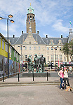 Historic Stadhuis building Rotterdam, Netherlands constructed 1920 with Mari Andriessen's Memorial to the Fallen 1940-1945 – four bronze figures – from 1957 commemorates the victims of the Second World War.