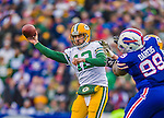 14 December 2014: Green Bay Packers quarterback Aaron Rodgers makes a forward pass in the second quarter against the Buffalo Bills at Ralph Wilson Stadium in Orchard Park, NY. The Bills defeated the Packers 21-13, snapping the Packers' 5-game winning streak and keeping the Bills' 2014 playoff hopes alive. Mandatory Credit: Ed Wolfstein Photo *** RAW (NEF) Image File Available ***