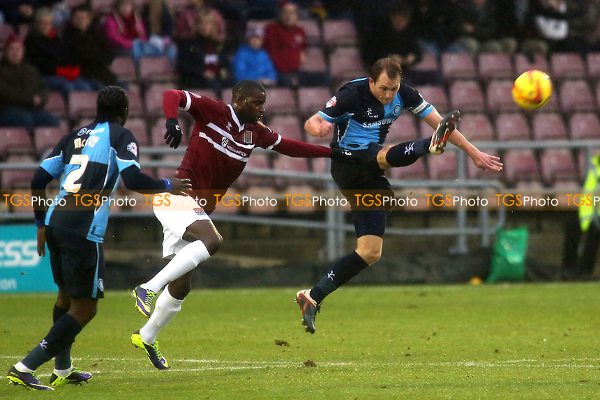 Wycombe's Stuart Lewis clears the ball upfield - Northampton Town vs Wycombe Wanderers - Sky Bet League Two Football at the Sixfields Stadium, Northampton - 21/12/13 - MANDATORY CREDIT: Paul Dennis/TGSPHOTO - Self billing applies where appropriate - 0845 094 6026 - contact@tgsphoto.co.uk - NO UNPAID USE