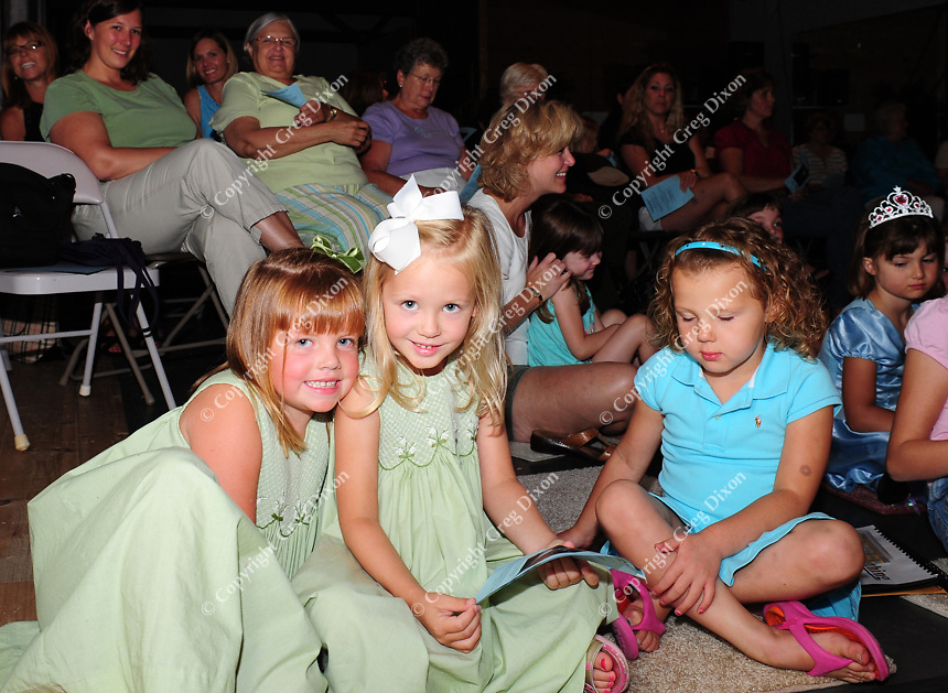 Lily Scott, Morgan Merckx, and Ella Graper (left to right) await the performance of Cinderella at the Stoughton Center for the Performing Arts on Sunday, 8/3/08
