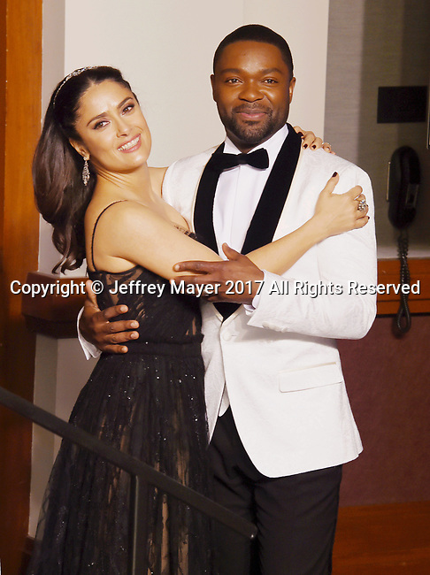 HOLLYWOOD, CA - FEBRUARY 26: Actress Salma Hayek (L) and actor David Oyelowo pose in the press room during the 89th Annual Academy Awards at Hollywood & Highland Center on February 26, 2017 in Hollywood, California.