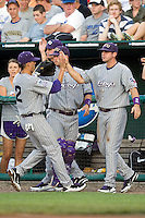 Jerome Pena is greeted by the TCU bench in Game 6 of the NCAA Division One Men's College World Series on Monday June 21st, 2010 at Johnny Rosenblatt Stadium in Omaha, Nebraska.  (Photo by Andrew Woolley / Four Seam Images)