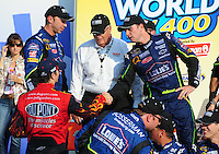 Sept. 28, 2008; Kansas City, KS, USA; Nascar Sprint Cup Series driver Jimmie Johnson (right) is congratulated by teammate Jeff Gordon after winning the Camping World RV 400 at Kansas Speedway. Mandatory Credit: Mark J. Rebilas-