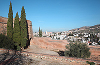 El Albayzin, the medieval Moorish old town of Granada, seen in the distance beyond the walls of the Alhambra Palace, Granada, Andalusia, Southern Spain. From the 8th to the 15th centuries, Granada was under muslim rule and retains a distinctive Moorish heritage. Granada was listed as a UNESCO World Heritage Site in 1984. Picture by Manuel Cohen