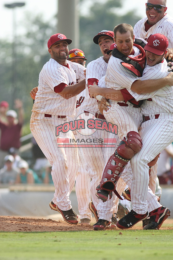 University of South Carolina Gamecocks celebrating their victory after winning the 2nd and deciding game of the NCAA Super Regional vs. the University of Coastal Carolina Chanticleers on June 13, 2010 at BB&T Coastal Field in Myrtle Beach, SC.  The Gamecocks defeated Coastal Carolina 10-9 to advance to the 2010 NCAA College World Series in Omaha, Nebraska.  Photo By Robert Gurganus/Four Seam Images