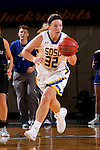 BROOKINGS, SD - NOVEMBER 3:  Sydney Palmer #32 from South Dakota State pushes the ball on a fast break against Dakota Wesleyan in the first half of their exhibition game Thursday night at Frost Arena. (Photo by Dave Eggen/Inertia)