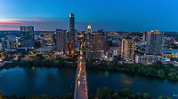 Beautiful aerial view of the Congress Avenue Bridge overlooking downtown Austin highrise skyscrapers into the Texas State Capitol.