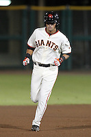 Scottsdale Scorpions second baseman Joe Panik #26 rounds the bases after hitting a home run during an Arizona Fall League game against the Peoria Javelinas at Scottsdale Stadium on November 1, 2011 in Scottsdale, Arizona.  Scottsdale defeated Peoria 6-4.  (Mike Janes/Four Seam Images)