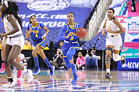 GREENSBORO, NC - MARCH 04: Jahsyni Knight #0 of the University of Pittsburgh brings the ball up the court during a game between Pitt and Notre Dame at Greensboro Coliseum on March 04, 2020 in Greensboro, North Carolina.