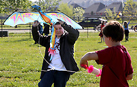NWA Democrat-Gazette/DAVID GOTTSCHALK  Nicholas Calvert (left) works with Asa Linn, both sixth grade students at Owl Creek School, Tuesday, April 18, 2017, as they launch a kite during a Soar Celebration at the school in Fayetteville. The school received a top ten ranking in the state from from Niche.com. Niche is a website that gathers comprehensive data about United State schools and neighborhoods. Students flew kites and released bubbles.