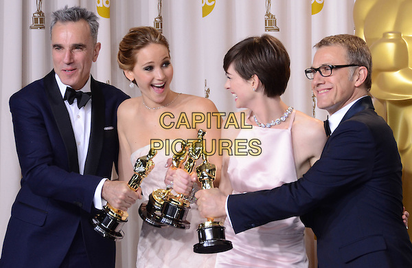 Daniel Day Lewis, Jennifer Lawrence, Anne Hathaway, Christoph Waltz.85th Annual Academy Awards held at the Dolby Theatre at Hollywood & Highland Center, Hollywood, California, USA..February 24th, 2013.pressroom oscars half length black mouth open tuxedo bow tie beard facial hair white profile smiling shirt award trophy trophies winner winners white pink pale strapless dress trophies winners glasses .CAP/ADM/RE.©Russ Elliot/AdMedia/Capital Pictures.