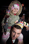 © Joel Goodman - 07973 332324 . 17 November 2013 . Oldham , UK . Daughter Ruby Warburton (four) and dad Jamie Warburton (both correct , from Oldham) watch the show . The Christmas lights are turned on in Oldham Town Centre . Photo credit : Joel Goodman