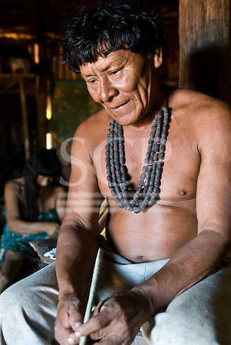 Xingu Indigenous Park, Mato Grosso State, Brazil. Aldeia Waura. Cacique and Pajé Ysautaku Waura with a shaman's long cigarette.