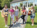 Niamh Breen, Nicole O'keeffe, Caoife McVeigh, Rebecca Byrne and Jennifer McKenna singing before the parents association charity walk from St Brigids school. Photo: Colin Bell/pressphotos.ie