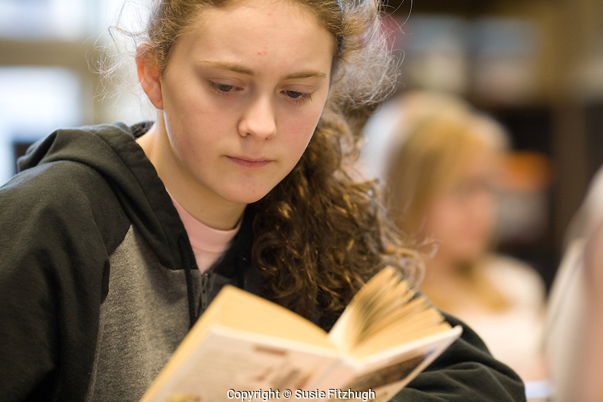 Ballard high school students read books in class.