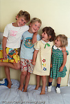 siblings lined up boys ages 9 and 6, and girls ages 4 and 2 vertical