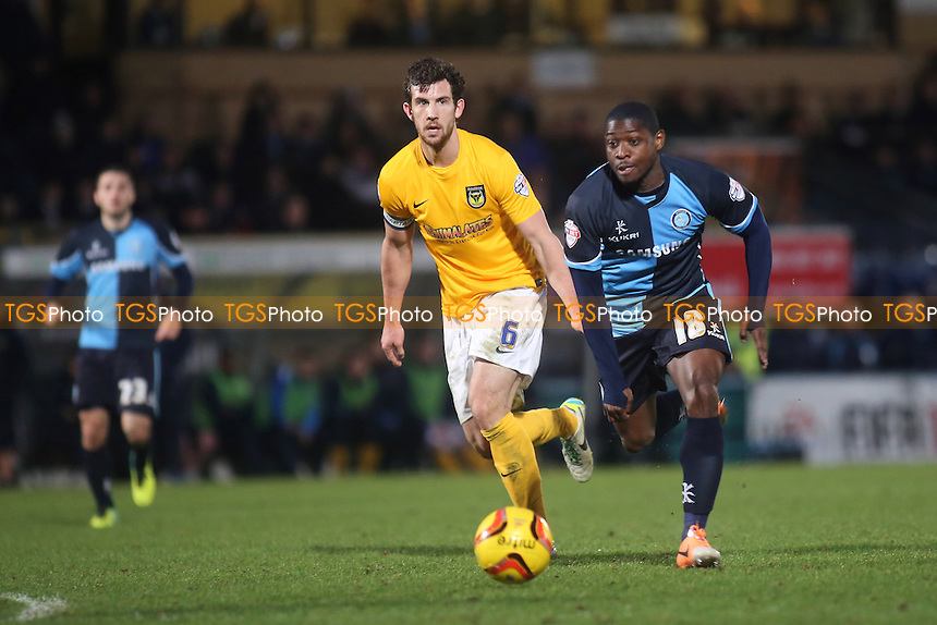 Wycombe's Jo Kuffour takes on the Oxford defence - Wycombe Wanderers vs Oxford United - Sky Bet League Two Football at Adams Park, High Wycombe, Buckinghamshire - 18/01/14 - MANDATORY CREDIT: Paul Dennis/TGSPHOTO - Self billing applies where appropriate - 0845 094 6026 - contact@tgsphoto.co.uk - NO UNPAID USE