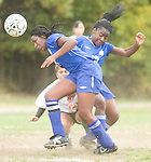 The Gazette Laurel teammates Chika Ugboh, left and Fri-Atsoh Achirimofor go for a bouncing ball during Laurel's match against Parkdale on Friday afternoon.