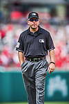22 June 2014: MLB Umpire Clint Fagan works third base during a game between the Washington Nationals and the Atlanta Braves at Nationals Park in Washington, DC. The Nationals defeated the Braves 4-1 to split their 4-game series and take sole possession of first place in the NL East. Mandatory Credit: Ed Wolfstein Photo *** RAW (NEF) Image File Available ***