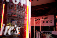 A Ron Paul Revolution sign hangs in the display window of a smoke shop in downtown Manchester, New Hampshire, on Jan. 7, 2012.  Paul is seeking the 2012 Republican presidential nomination.