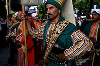 ISTANBUL - MAY 29, 2007:   A man in Ottoman dress gets ready for a National Parade.  Istanbul, Turkey. Photo by Landon Nordeman.