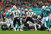 1st October 2017, Wembley Stadium, London, England; NFL International Series, Game Two; Miami Dolphins versus New Orleans Saints; T. J. McDonald of the Miami Dolphins is tackled to the floor