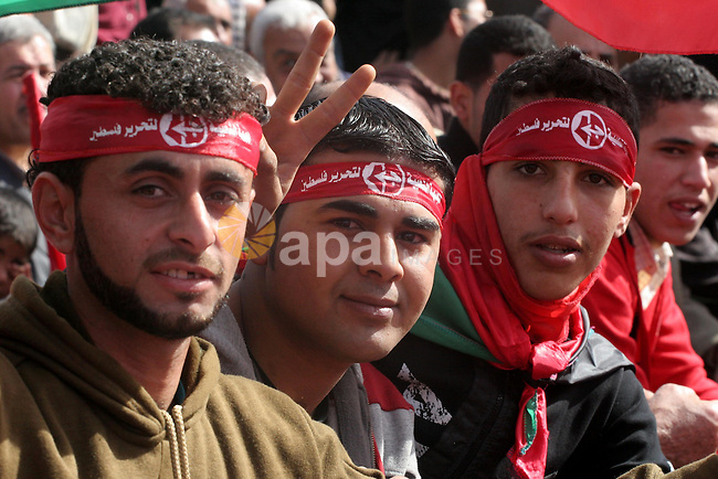 Palestinian youths take part in a rally organised by the Popular Front for the Liberation of Palestine (PFLP) to celebrate the 42nd anniversary of its establishment in Gaza City on December 12, 2009. Photo by Mohammed Asad