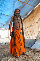 Kumbh Mela Hindu Festival, 2013, occurs every 12 years. Religious pilgrims taking holy bath in the Ganges River, Allahabad. Sadhu, grown hair for 44 years. Baba Amagrin,