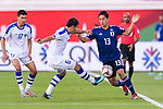 Muto Yoshinori of Japan (R) fights for the ball with Davronbek Khashimov of Uzbekistan (C) during the AFC Asian Cup UAE 2019 Group F match between Japan (JPN) and Uzbekistan (UZB) at Khalifa Bin Zayed Stadium on 17 January 2019 in Al Ain, United Arab Emirates. Photo by Marcio Rodrigo Machado / Power Sport Images