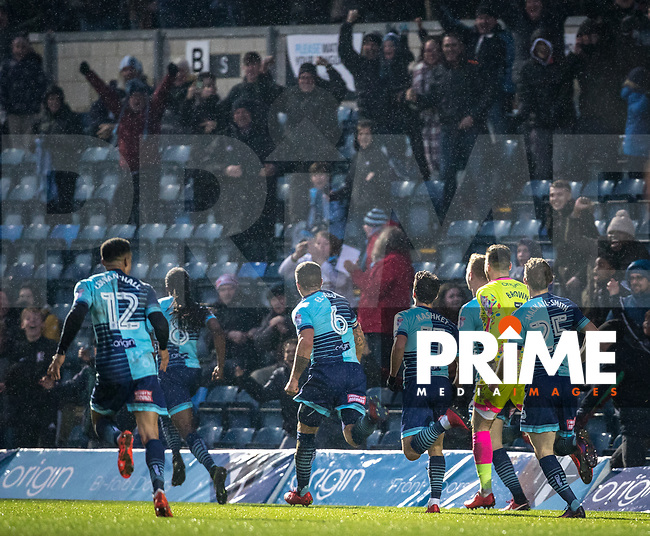 Teammates follow winning goalscorer Marcus Bean of Wycombe Wanderers during the Sky Bet League 2 match between Wycombe Wanderers and Carlisle United at Adams Park, High Wycombe, England on 3 February 2018. Photo by Andy Rowland.