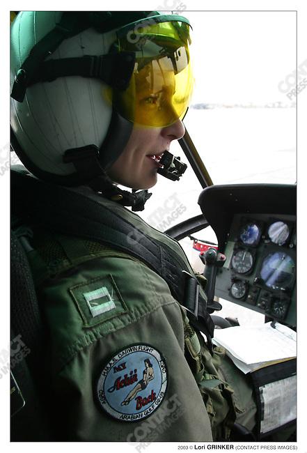 Helicopter pilot Lt. Lydia Duffy from Troy Ohio,  flying supplies and blood to the USNS Naval hosptial ship. USNS COMFORT Naval hospital ship in the Persian Gulf.