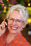 Woman on cell phone smiling