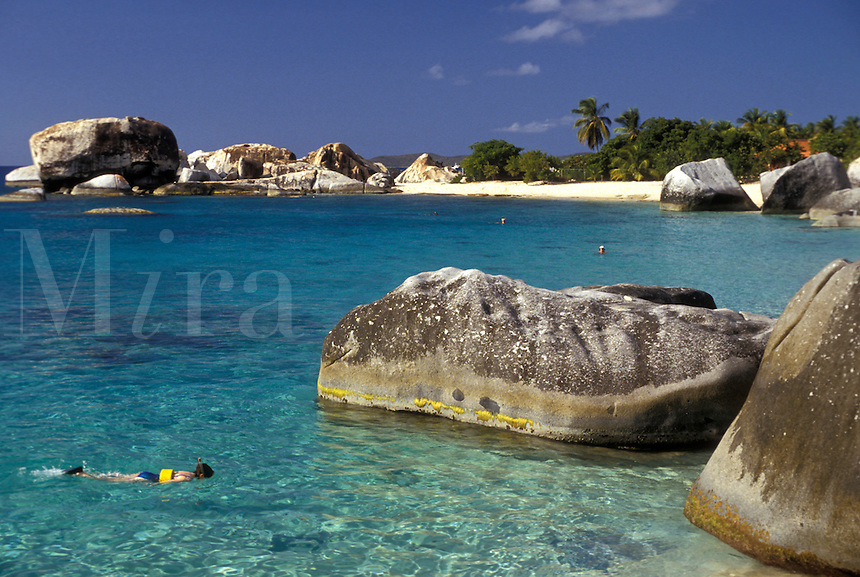 AJ2390, Virgin Gorda, British Virgin Islands, Caribbean, beach, Virgin Islands, BVI, B.V.I., Person snorkling around big boulders on Spring Bay on the island of Virgin Gorda on the British Virgin Islands.