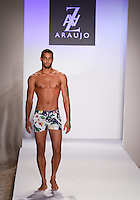 Model walks runway at A.Z Araujo Swimwear Show during Mercedes Benz IMG Fashion Swim Week 2013 at The Raleigh Hotel, Miami Beach, FL on July 23, 2012