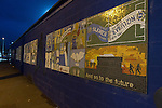 Macclesfield Town 0 Gateshead 4, 22/02/2013. Moss Rose, Football Conference. The murals depicting the club's history outside the stadium before Macclesfield Town host Gateshead at Moss Rose in a Conference National fixture. The visitors from the North East who were in the relegation zone, shocked Macclesfield with four first half goals and won 4-0 in front of 1467 fans. Both teams were former members of the Football league, with Macclesfield dropping out in 2012. Photo by Colin McPherson.