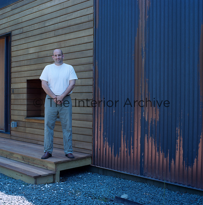 The corrugated copper panelling weathers and darkens to a blue-black in contrast with an adjacent wall clad in natural tongue-and-groove