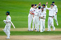 Picture by Alex Whitehead/SWpix.com - 22/04/2018 - Cricket - Specsavers County Championship Div One - Yorkshire v Nottinghamshire, Day 3 - Emerald Headingley Stadium, Leeds, England - Yorkshire's Ben Coad celebrates with team-mates after taking the wicket of Notts' Jake Libby.