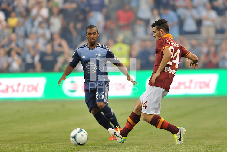 Sporting Park, Kansas City, Kansas, July 31 2013:<br /> Alessandro Florenzi (24) midfield AS Roma passes the ball, watched by Corey Ashe.<br /> MLS All-Stars were defeated 3-1 by AS Roma at Sporting Park, Kansas City, KS in the 2013 AT & T All-Star game.