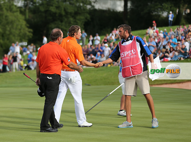 Peter Uihlein (USA) shakes hands with his caddie at the end of his round at the 2013 ISPS Handa Wales Open from the Celtic Manor Resort, Newport, Wales. Picture:  David Lloyd / www.golffile.ie