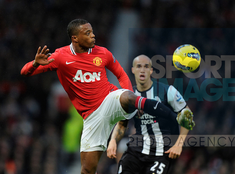Patrice Evra of Manchester United and Gabriel Obertan of Newcastle United